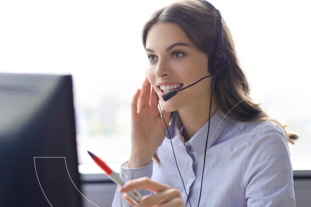 An IT help desk agent on the phone with a customer.